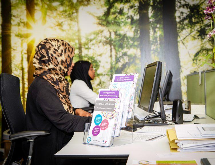 Staff at desk working