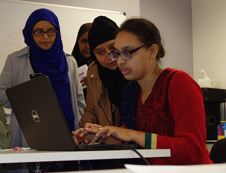 Students around the laptop