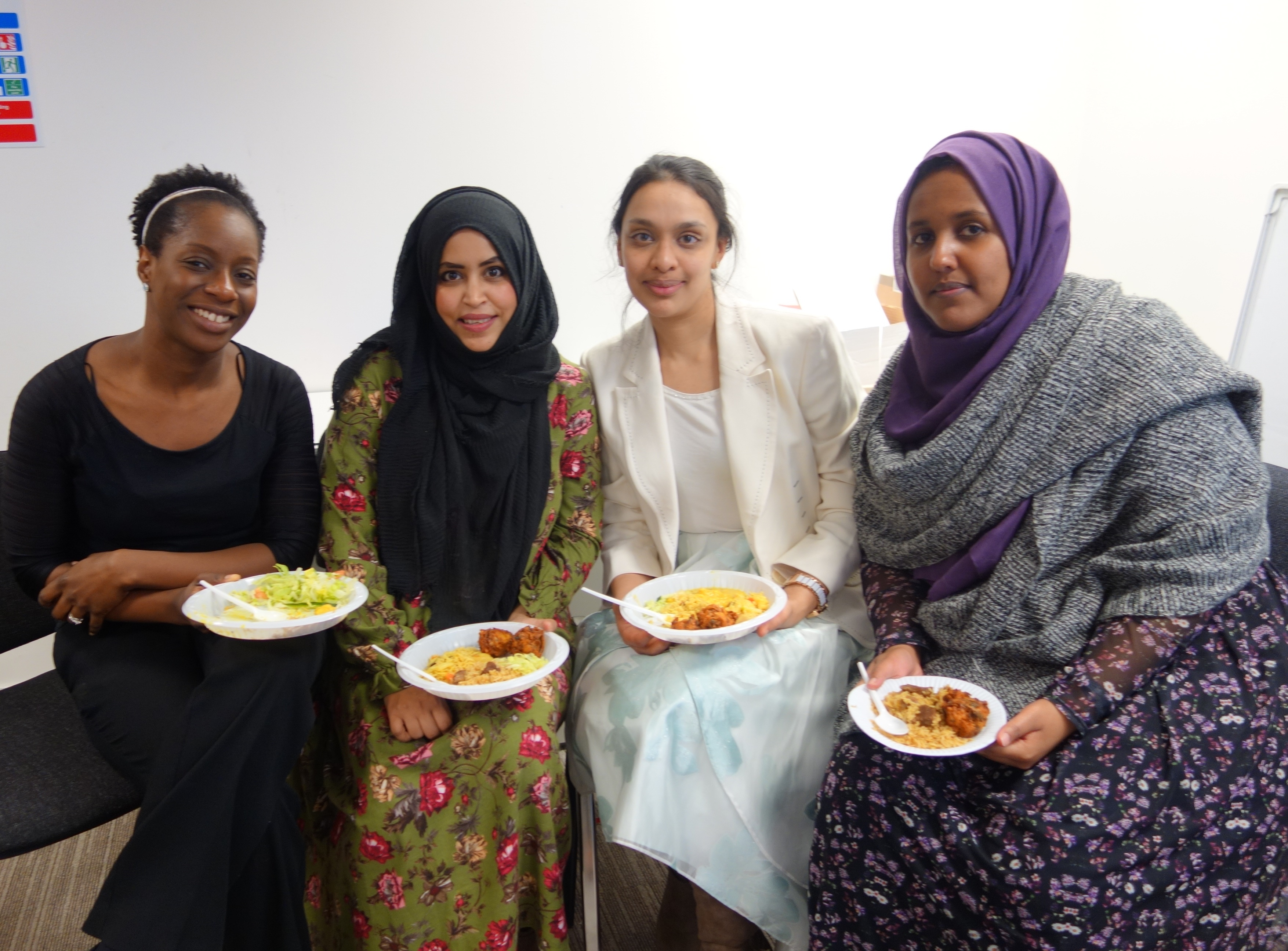 Group of four ladies sitting with food